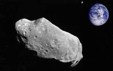 """Un asteroide passa """"tocant"""" la Terra"""