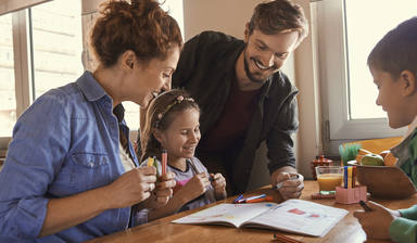 young family drawing together and having fun